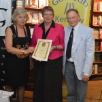 Grand Bard presenting award to Helen Doe and Alston Kennerley